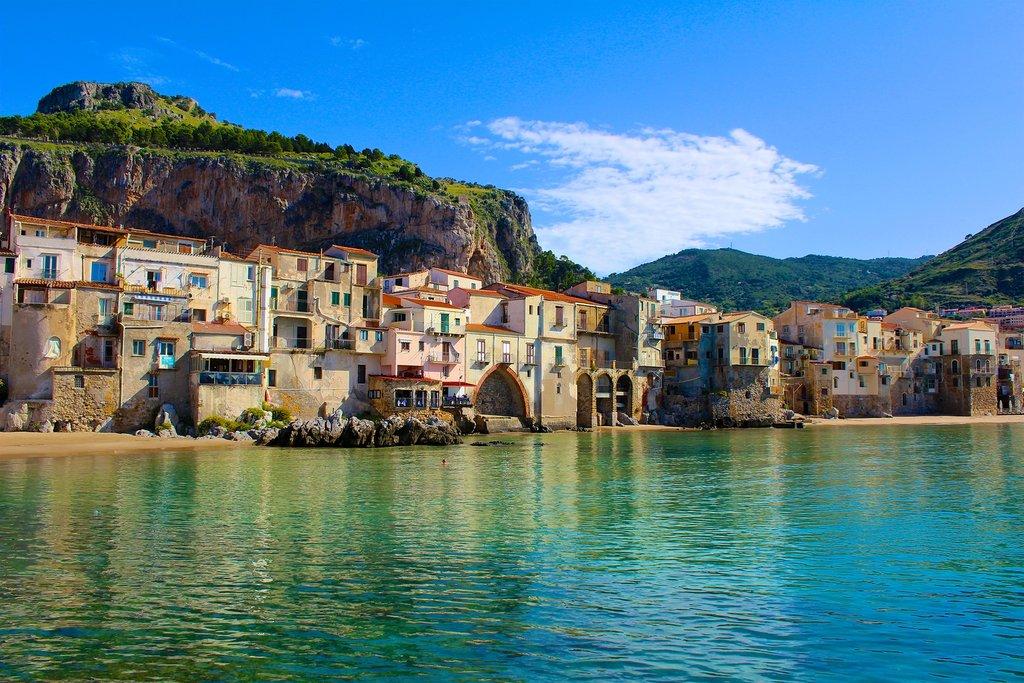 Take a passeggiata along Cefalù's seaside promenade