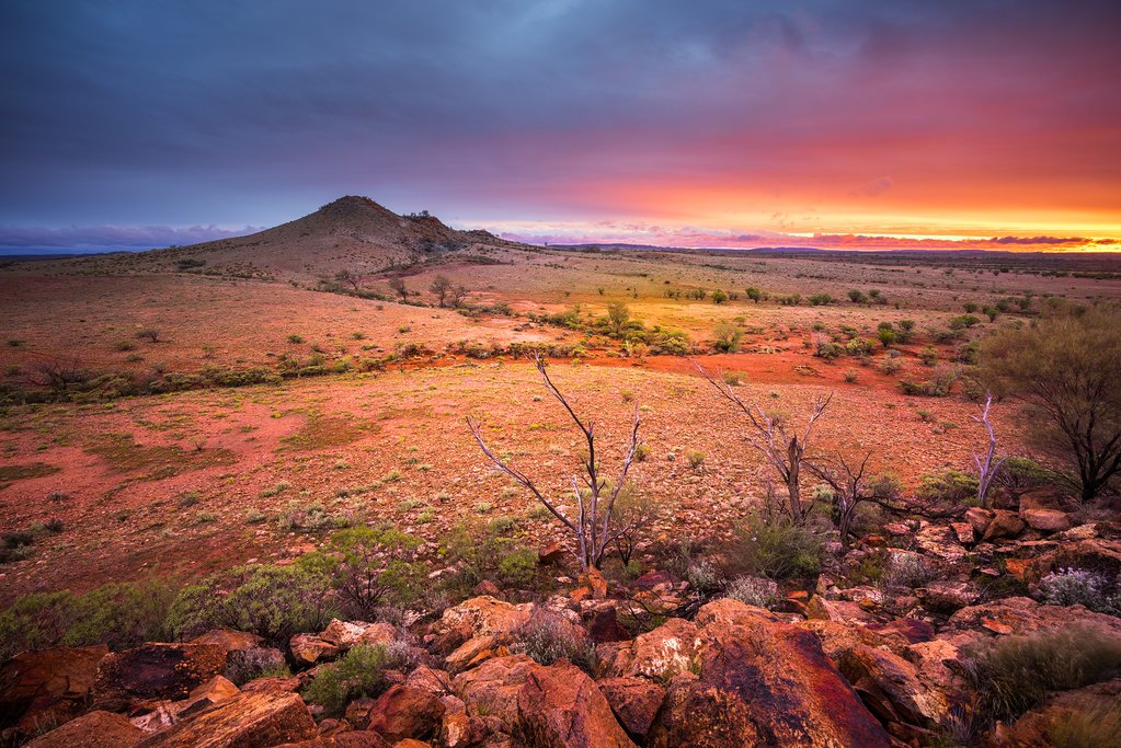 Enjoy breathtaking outback sunsets as you journey through the heart of Australia