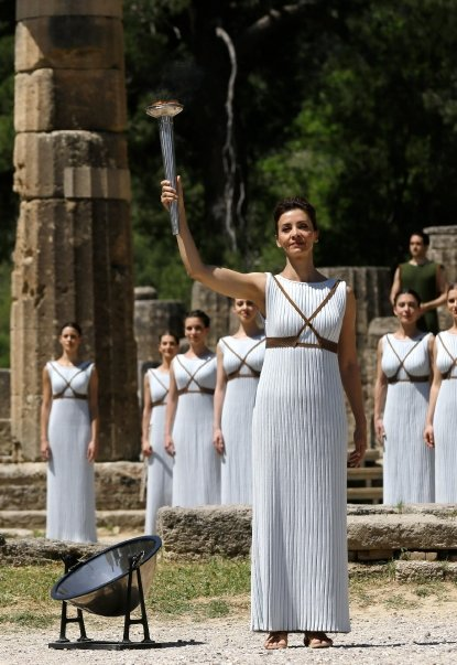 The fire is lit in Ancient Olympia and travels to the Beijing Olympic Games