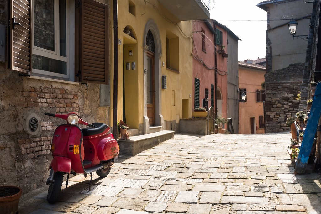 Vespa waiting for adventure in a Tuscan town