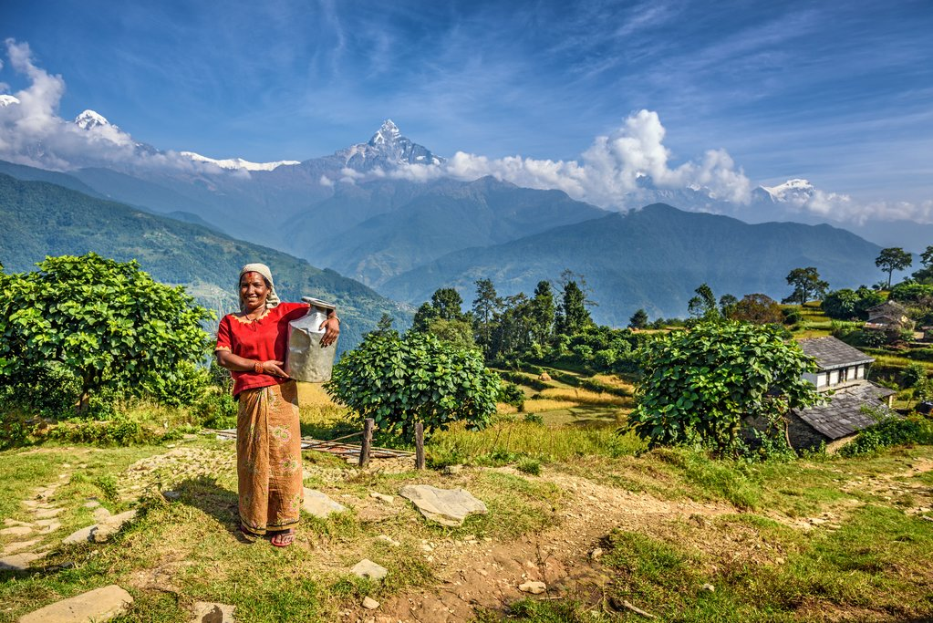 Nepalese woman in front of her home in Dhampus, Nepal