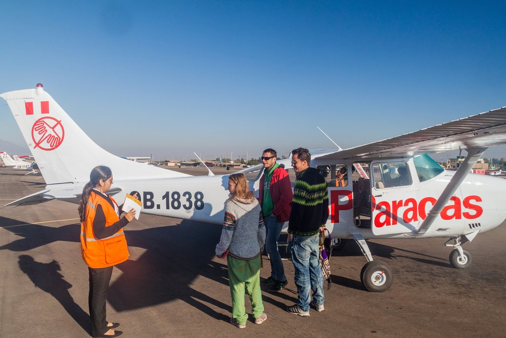 Boarding a small plane for a ride over the Nazca Lines