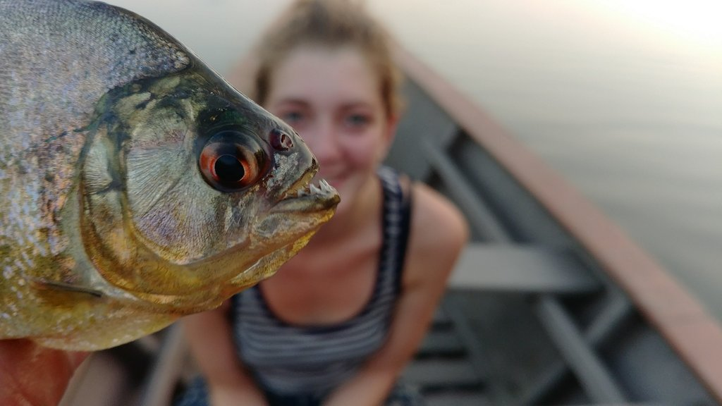 One of our guests with the piranha she'll be eating for dinner!