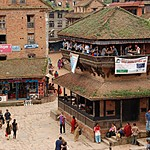 Travelers eating at a popular café in one of Bhaktapur's squares