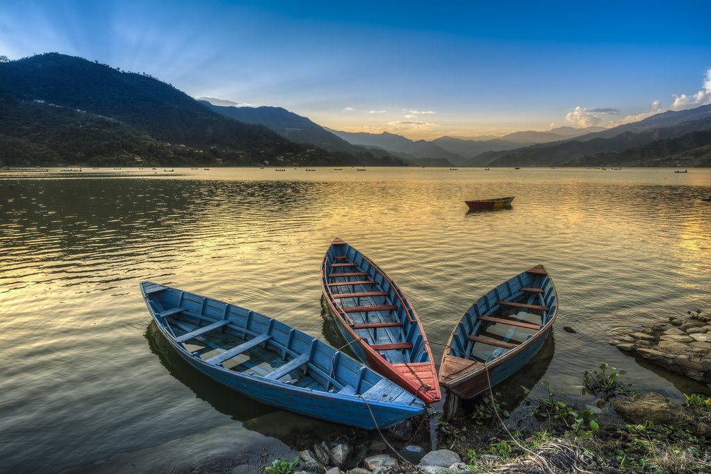 Boats along the shore of Phewa Lake