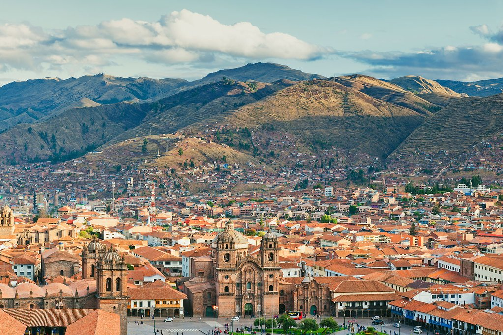 An aerial view of Cusco and surrounding hills