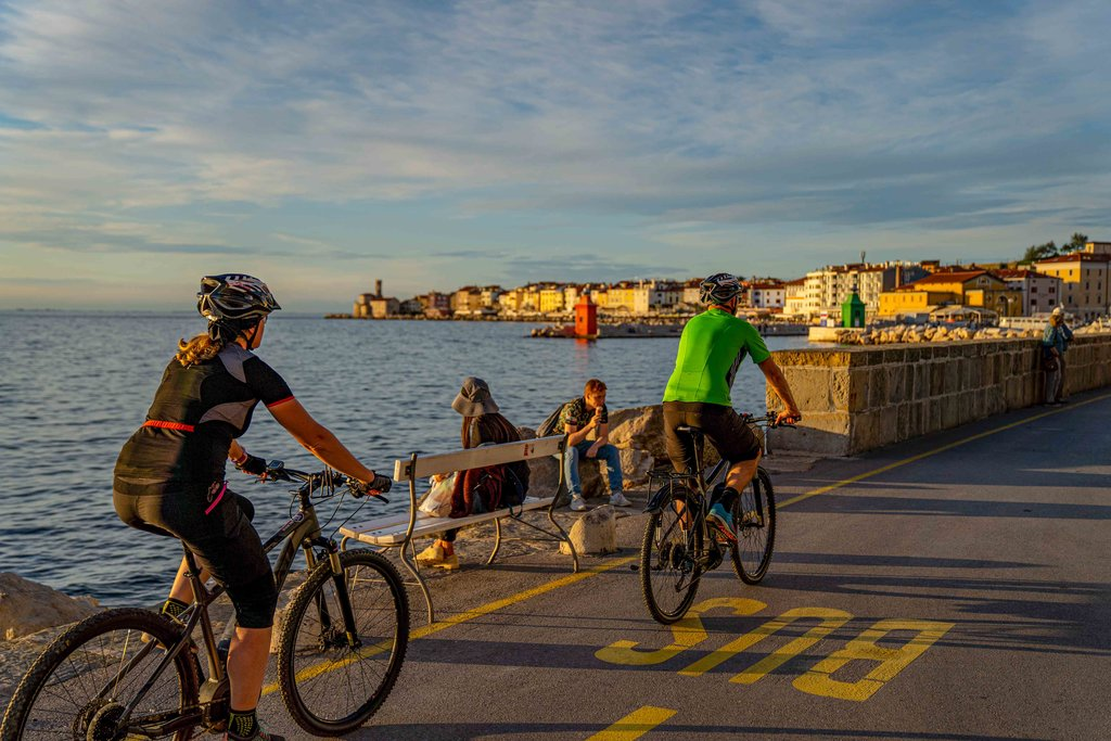 Cycling at sunset along the Adriatic Coast.