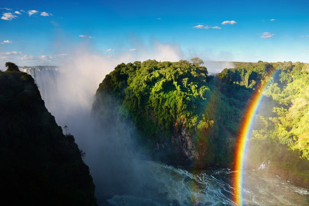 Rainbow created by mist at Victoria Falls