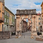 The ancient Roman Triumphal Arch of the Sergii