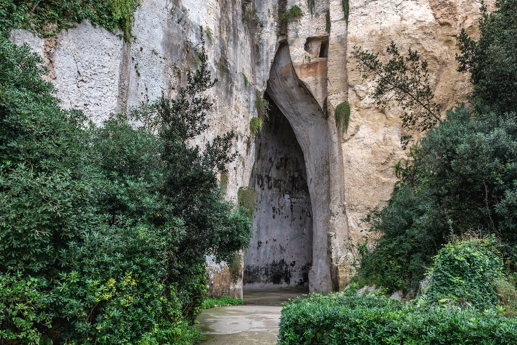 Italy - Sicily - Syracuse - Entrance to the Ear of Dionysius cave in Neapolis Archaeological Park