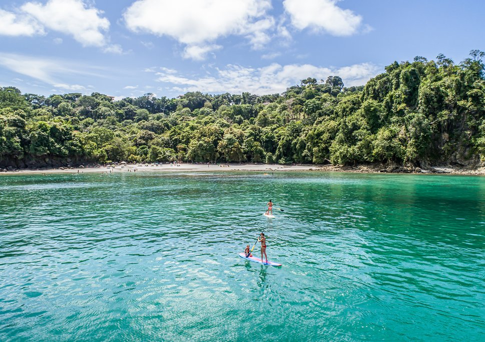 Swim, paddle, or snorkel in the pristine waters off Manuel Antonio National Park