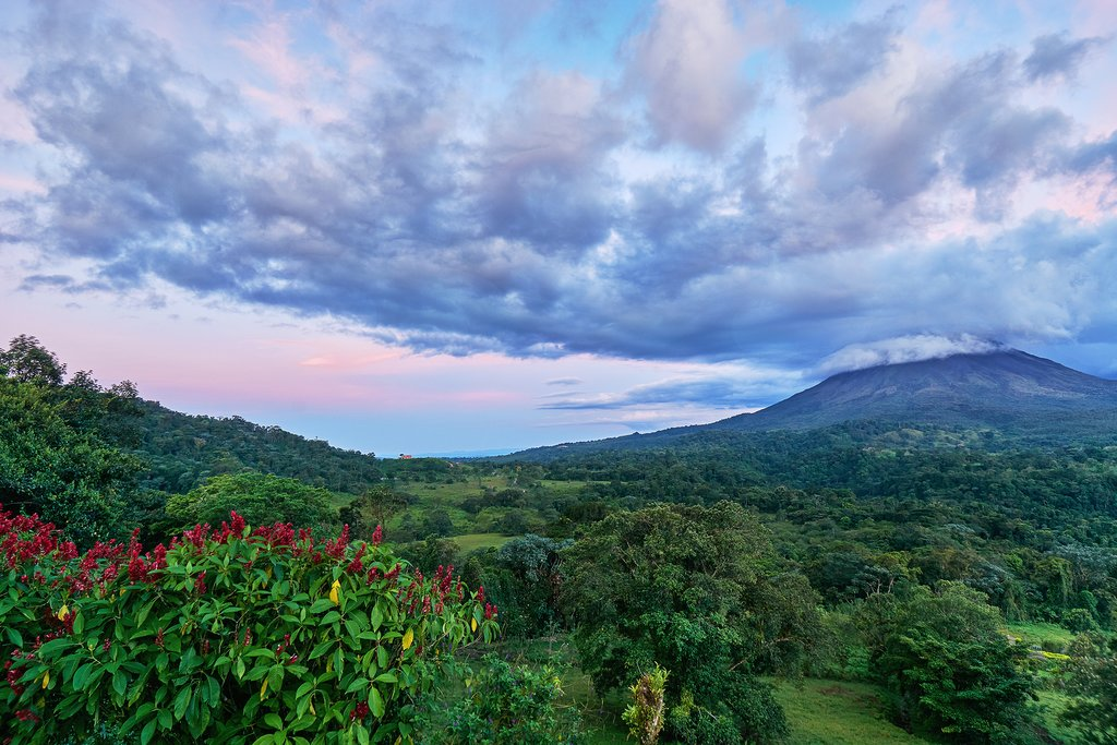Lush jungles surround the active Arenal Volcano