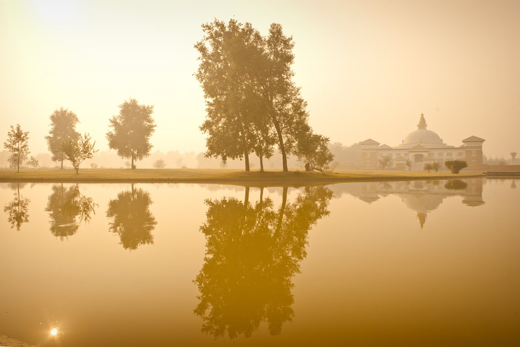 Reflections of the temple on the lake in Lumbini