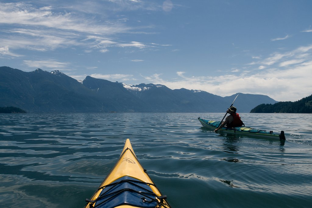 Lone kayaker paddles off Vancouver Island's western shore