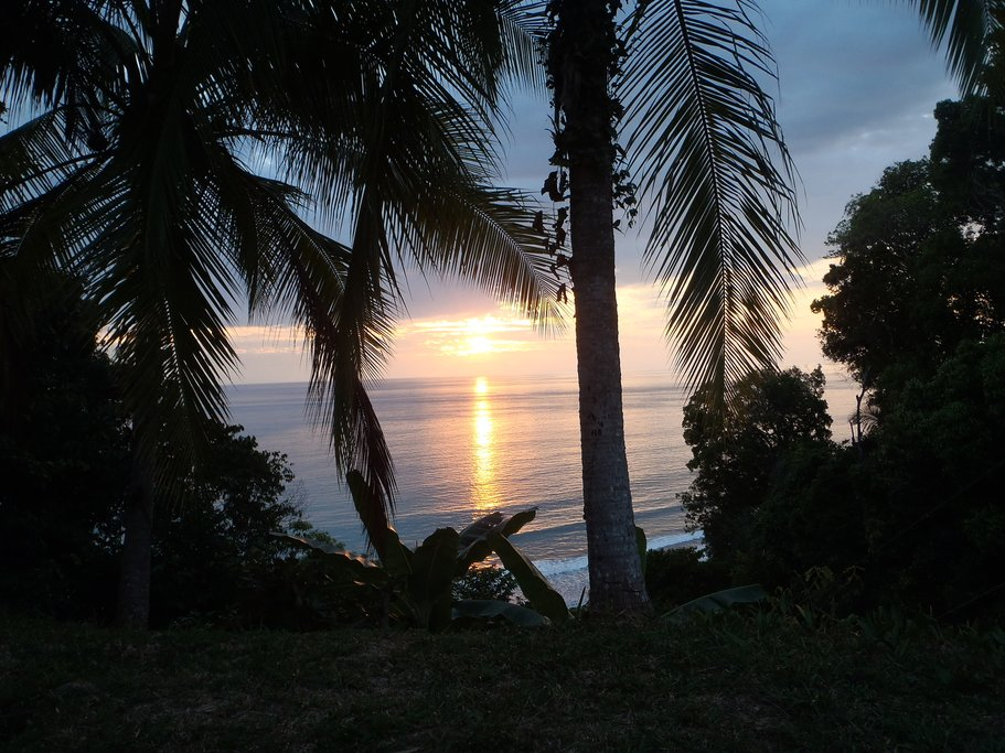 Take in the beautiful sunset over the ocean in Uvita