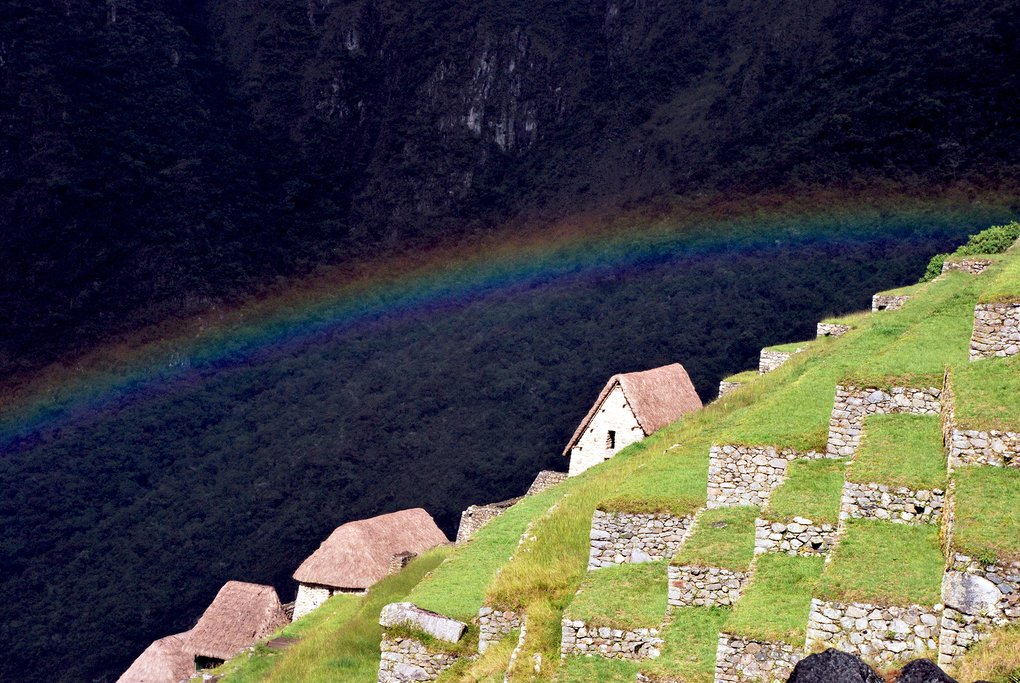 Rainbow over Machu Picchu terraces