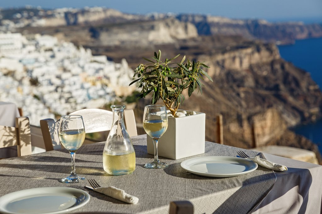 White wine with a view on Santorini island, Greece