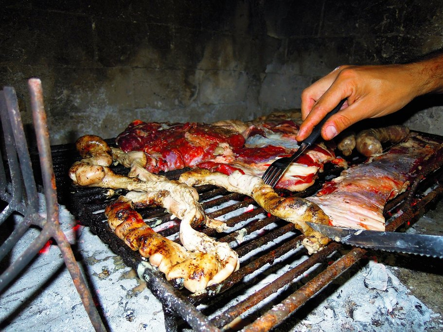 Steaks on the parrilla (grill) at an Argentine asado