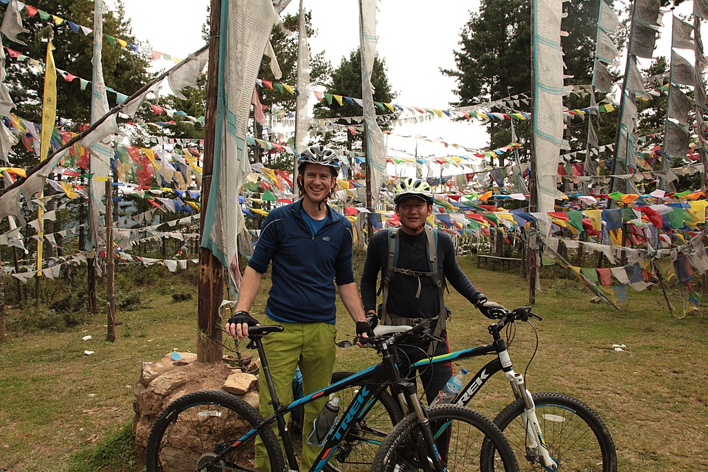 A pair of travelers biking to Paro