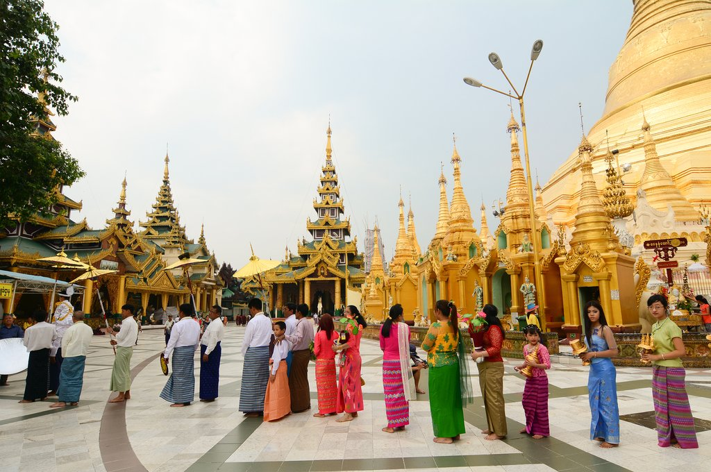 People praying at Shwedagon Pagoda in Yangon, Myanmar