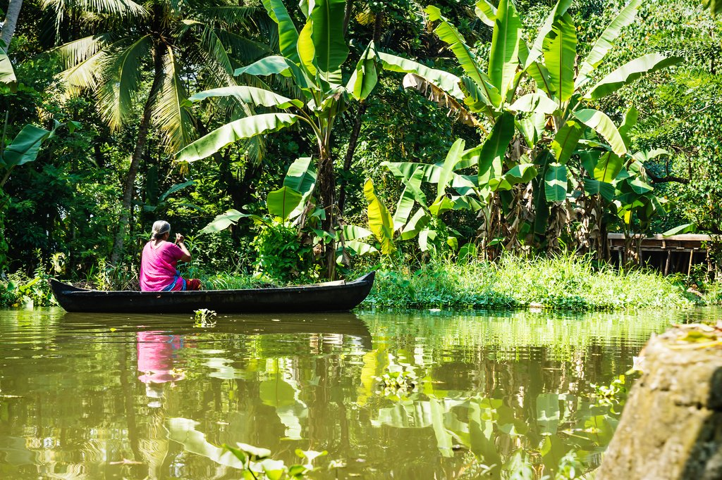 A local paddles a boat in Alleppey