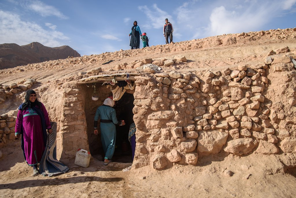 A Berber family in a traditional cave dwelling, Morocco