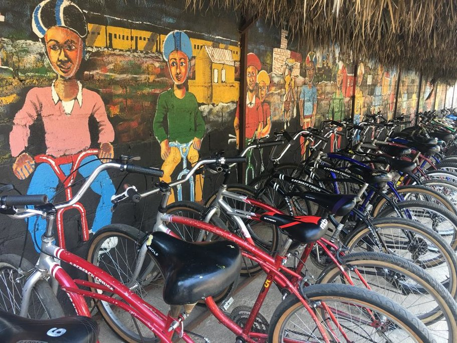 Soweto's street art and bicycles perched along the wall