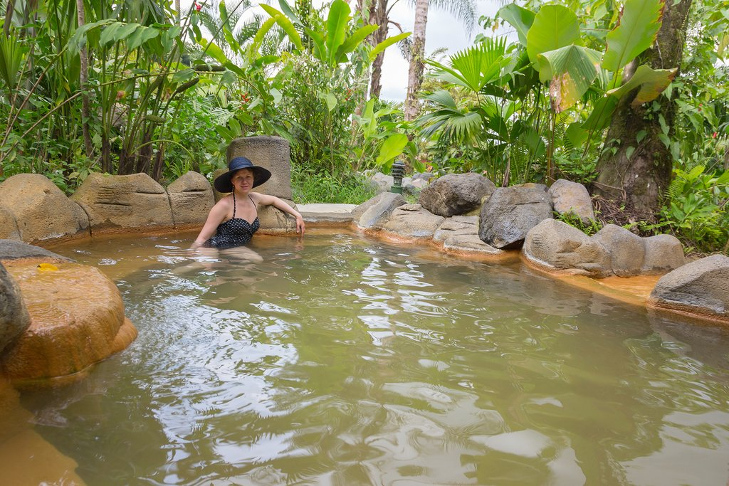 Soak in the hot springs after a hike through Arenal