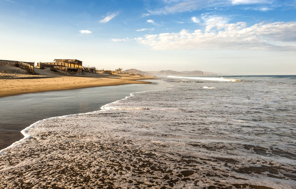 People are drawn to Northern Peru's enticing sandy beaches, such as this one at Mancora