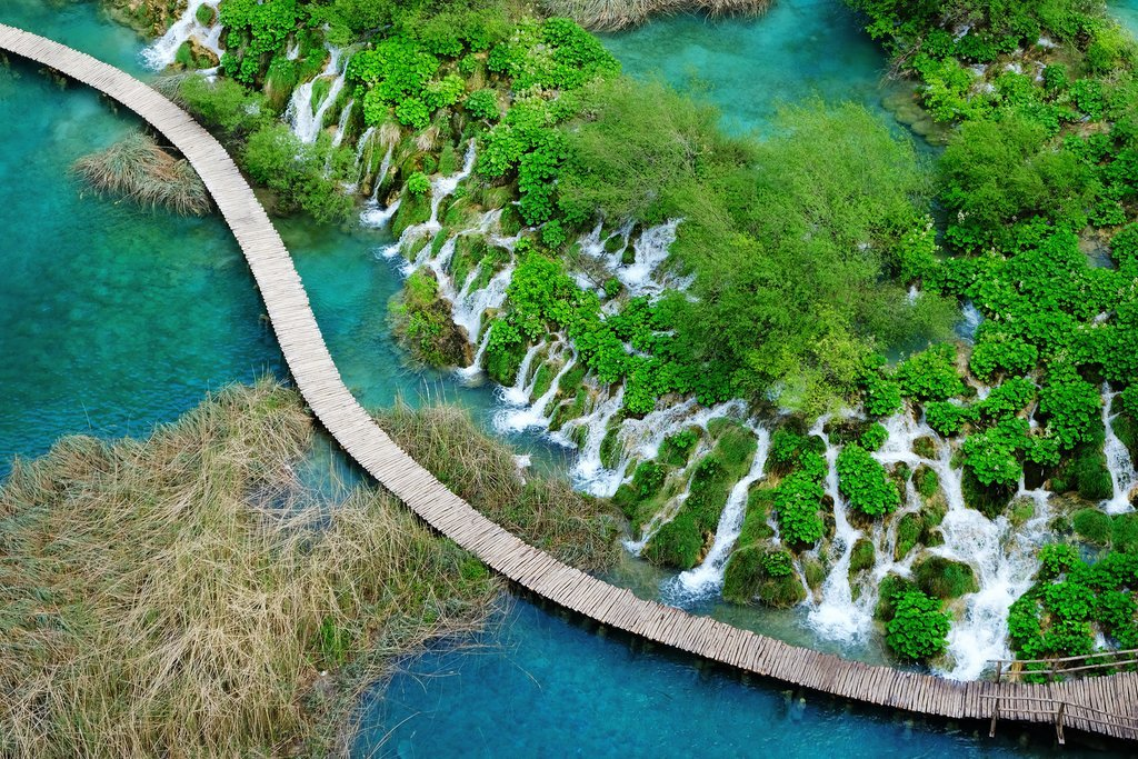 Aerial view over Plitvice Lakes National Park and winding boardwalk
