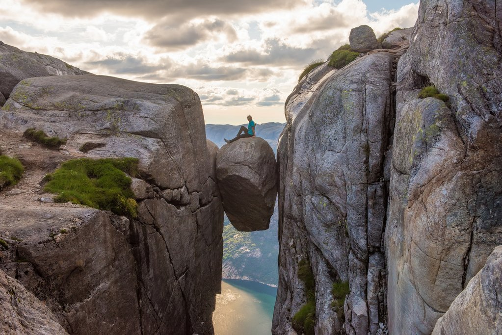 Stand suspended in the sky as you cross Kjerag's Boulder