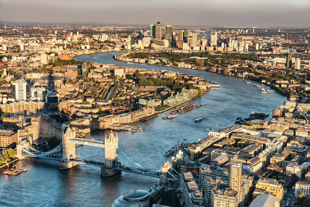 London city skyline aerial view at sunset with The Shard tower shadow, UK, Great Britain