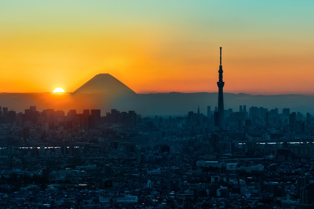 Sunset over Tokyo and Mount Fuji in the distance.