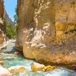 You'll cross crystal streams through narrow passages in Samaria Gorge