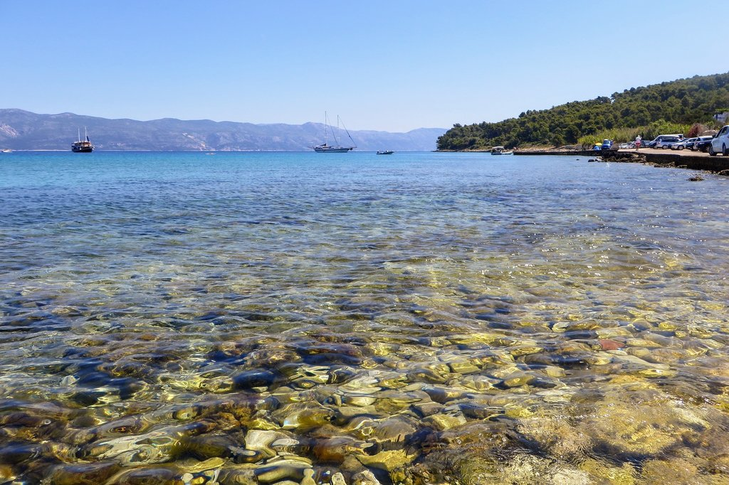 Pristine waters off the coast of Lumbarda with Pelješac peninsula in the background