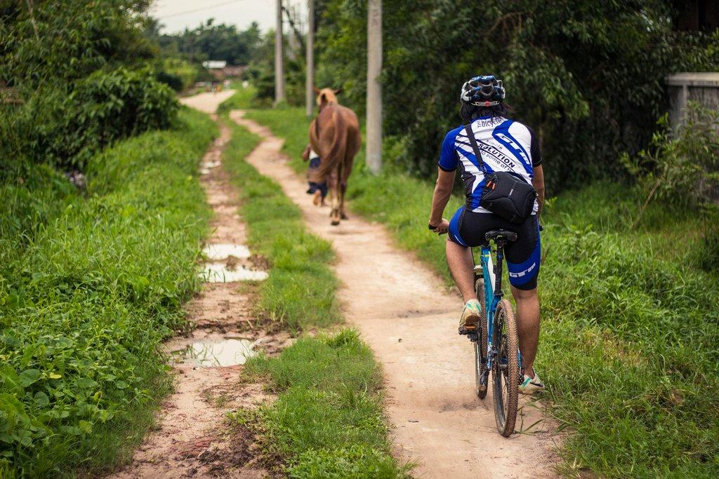 Cycling on a rural road, Yangon, Myanmar