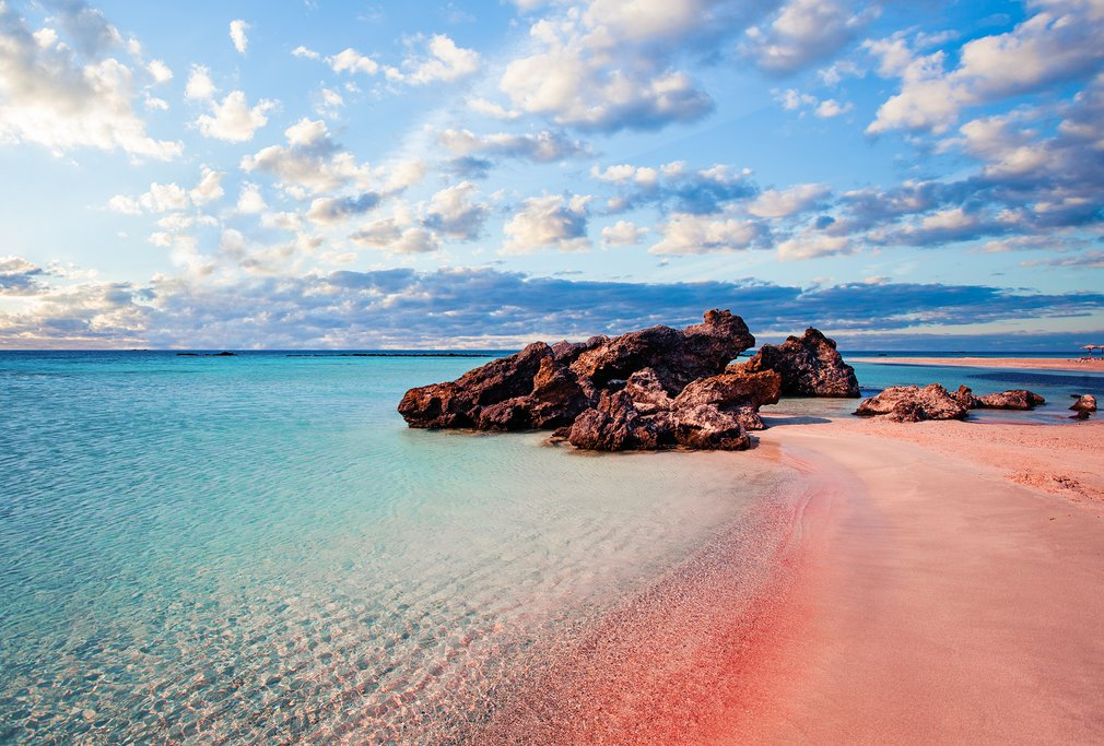 Pink sand and turquoise waters of Elafonisi beach on the southwest side of Crete