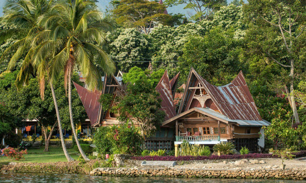 Traditional Batak architecture on the banks of the Bohorok River