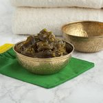 A vessel filled with Savon Beldi, traditional Moroccan black soap
