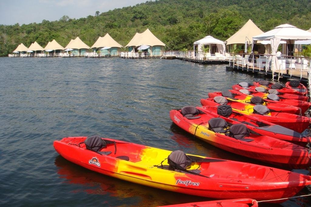 Go kayaking along the river in Koh Kong's beautiful 4 Rivers Floating Lodge