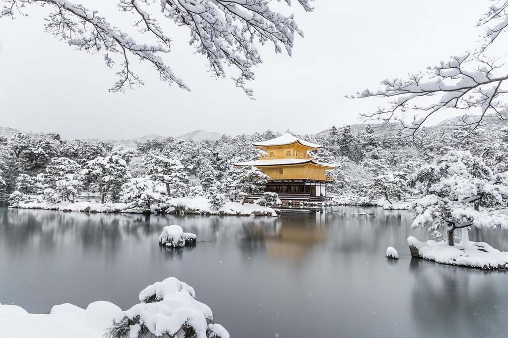 Snowfall over Kyoto's Golden Temple.