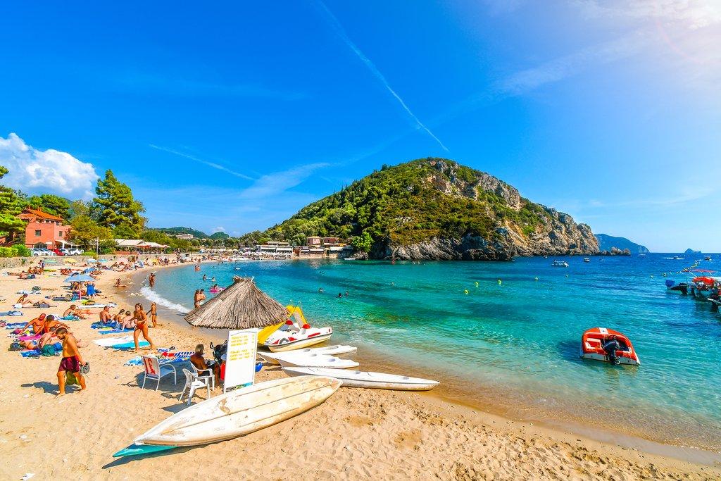 The sandy beach and clear waters of Palaiokastritsa beach on Corfu.