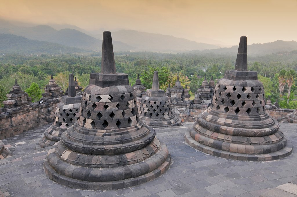 Visit the iconic stupas in Borobudur Temple