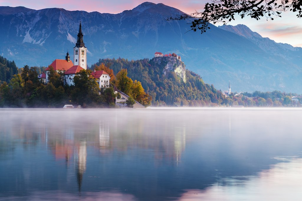The iconic old church at sunrise over Lake Bled
