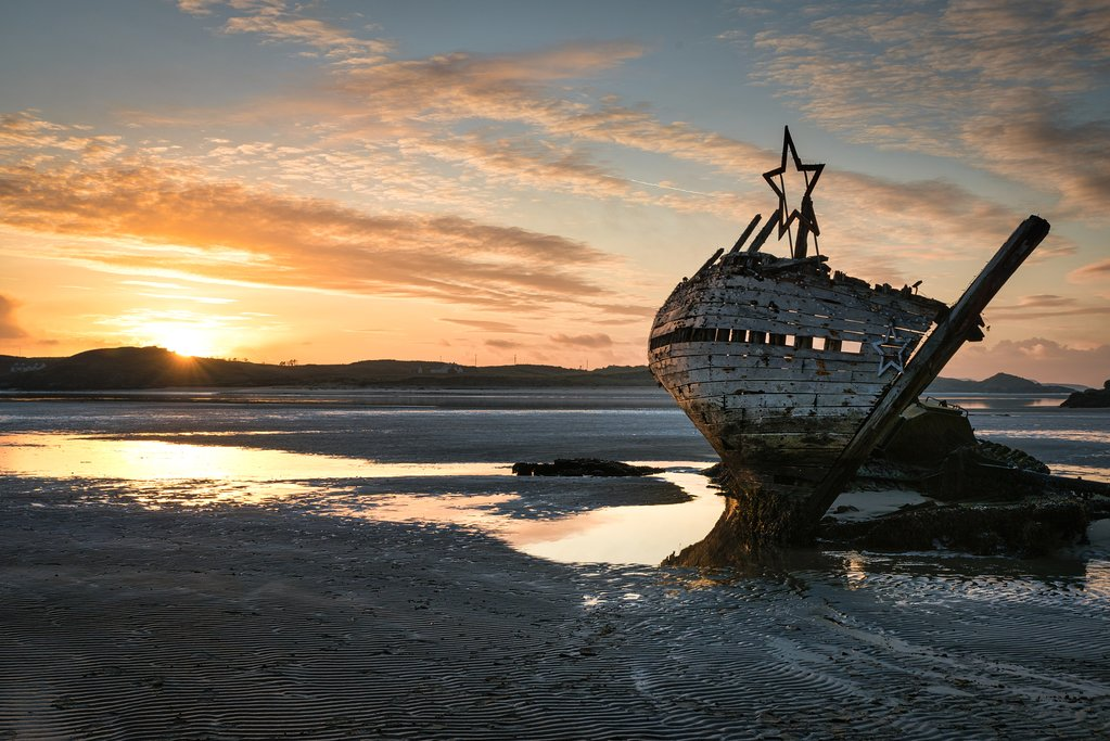 An old shipwreck at sunset in Bunbeg
