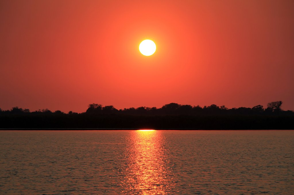 Sunrise over Guma Lagoon in Okavango Delta