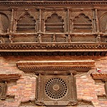 Intricate woodcarving on window frames in Bhaktapur