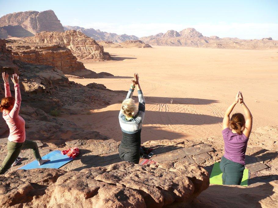Yoga on rocks in Wadi Rum