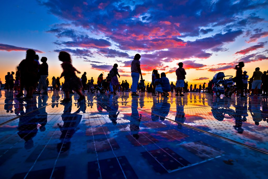 Silhouettes of people on Zadar's Monument to the Sun