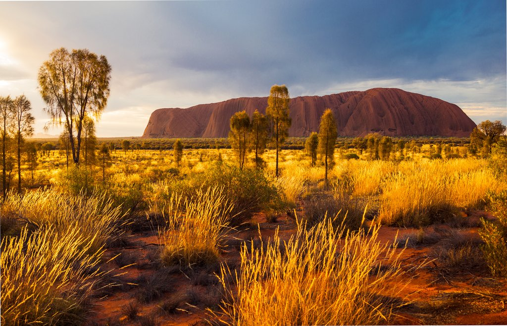Watch the sun set over Uluru, the iconic red rock